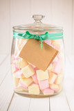 Candy jar filled with marshmallows and a blank tag