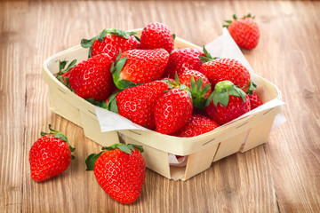 fresh strawberry in a wooden container