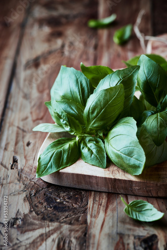 Fresh basil on a wooden chopping board