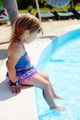 toddler near pool