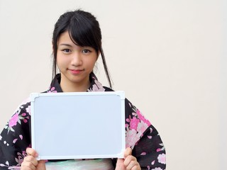 Japanese girl wearing kimono and whiteboard