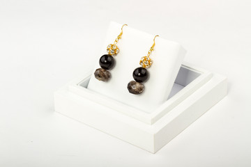 natural stone beads earrings on a stand