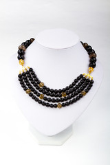 natural stone beads necklace on a stand