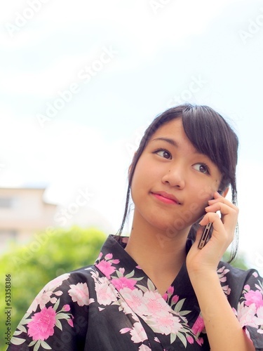 Kimono girl and smart phone