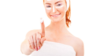 Face cream woman showing on finger