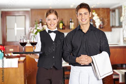 Leinwandbild Motiv Kellner und Kellnerin im Restaurant