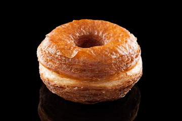 Croissant and doughnut mixture isolated on black