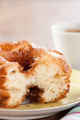 Croissant and doughnut mixture on a dish close-up