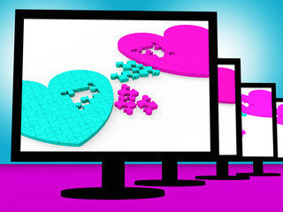 Two Hearts On Monitors Showing Celebrities' Romances