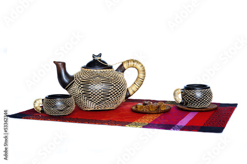 Teapor,cup and sugar.African style.