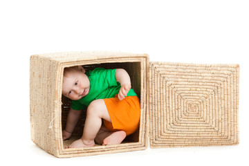 little boy  inside a box on a white background