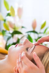 Wellness - woman getting head massage in Spa