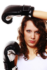 Fit woman boxing - isolated over white