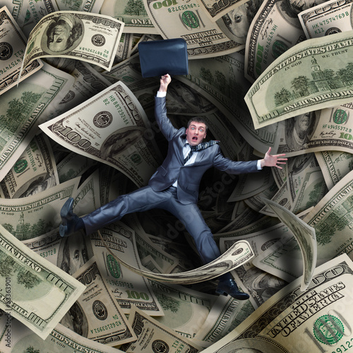Businessman falling into financial tunnel