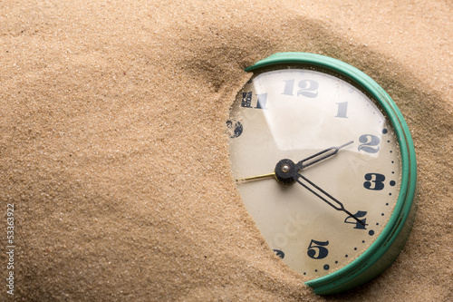 Alarm clock in sand