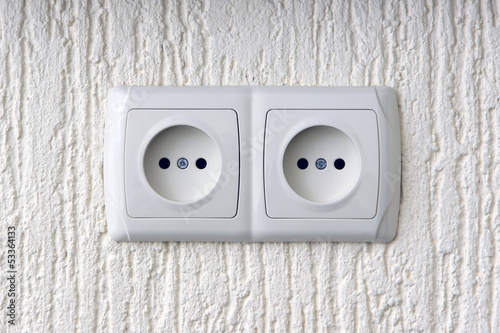 Two sockets  on wall
