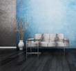 Gray couch in front of blue wall