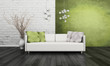 Modern white couch against green wall