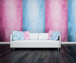 Modern white couch in front of pink and blue wall