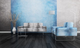 Gray and blue couch in front of colorful wall