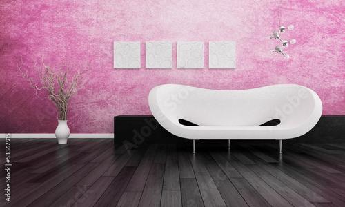 Modern white design sofa against pink wall