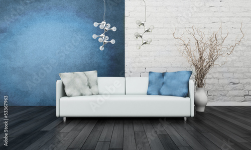 White couch in front of blue wall