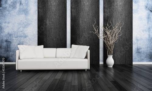 White couch in front of blue and black wall