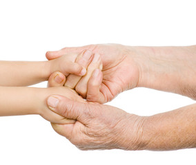 hands of the old man hold a hand of the baby. isolated on white
