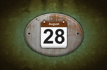 Old wooden calendar with August 28.