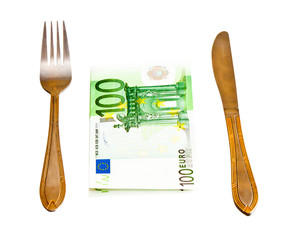 Money with fork and knife, isolated on white background