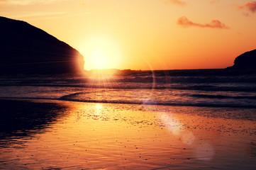sun flare sunset beach