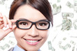 business woman touch eye glasses with money rain