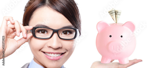 business woman and pink piggy bank