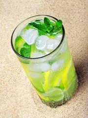 mojito cocktail on the sea sand