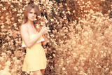 Blonde woman posing on a yellow Flower Glade