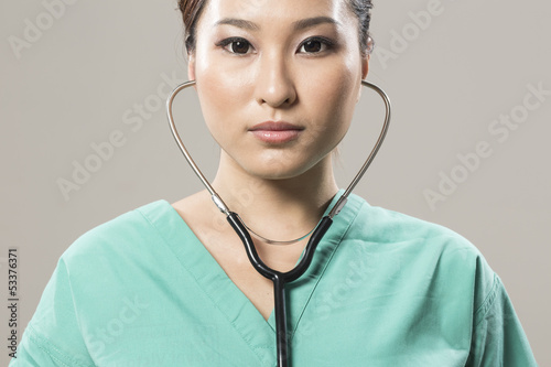 Chinese Female sergeon listening to a stethoscope