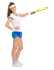 Female tennis player pointing on copy space with racket