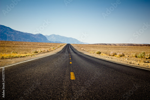 Desolate highway through desert in California