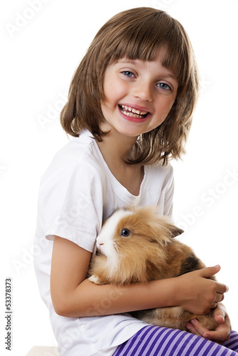 little girl with a baby rabbit