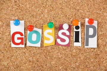 The word Gossip on a cork notice board