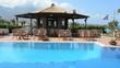 The swimming pool near bar and Greek flag, Peloponnes, Greece