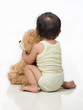 back view baby and teddy bear