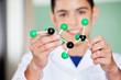 Schoolboy Examining Molecular Structure In Lab