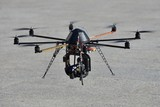 Police unmanned helicopter (UAV) with a camera for observation poster