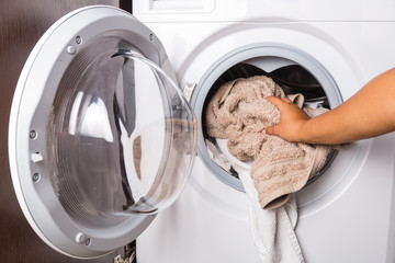 Hand loading laundry to the washing machine