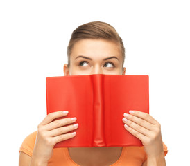 woman eyes and hands holding red book