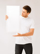 young man holding white blank board
