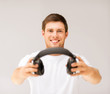 young smiling man offering headphones