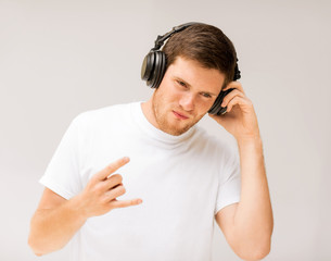 man with headphones listening rock music