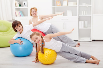 Kids exercising with their mother